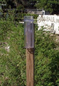 Manual rain gauge in yard