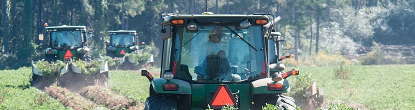 Agriculture equipment operators work in a field. [CREDIT: U.S. Dept. of Agriculture]