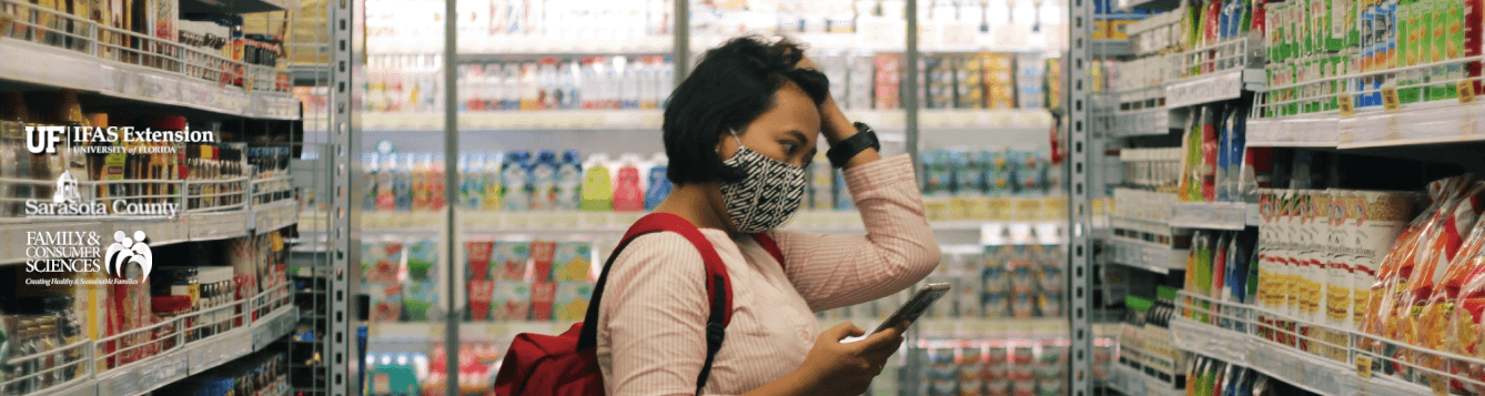 A shopper grapples with products and technology in a grocery store [CREDIT: pxhere.com, Viki Mohamad]