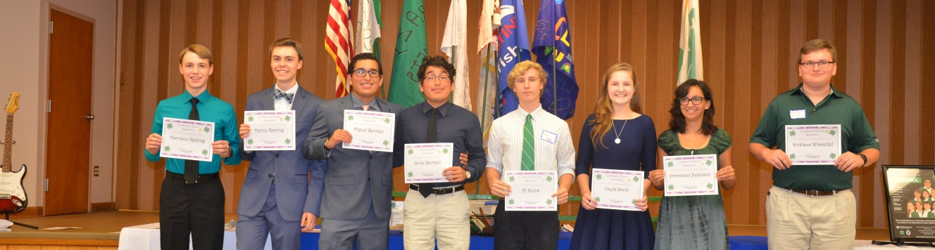Eight teenagers holding certificates recongnizing them for their leadership