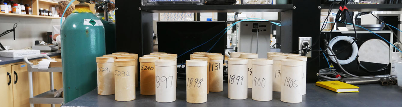 canisters of soil samples in lab