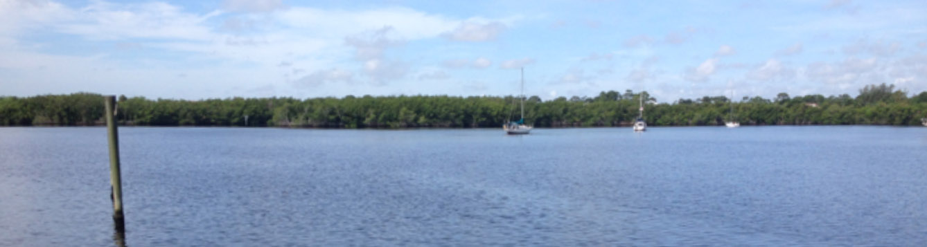 North Fork of St. Lucie River, Florida, boat in the distance