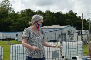 University professor holding algae in her hand.
