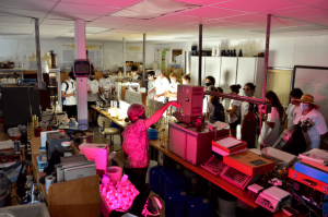 Students in a lab with red lights
