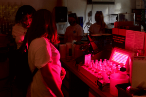 Students in a lab with red lights.