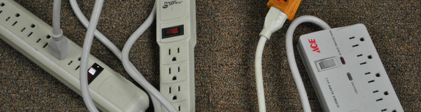 a tangle of power strips and extension cords